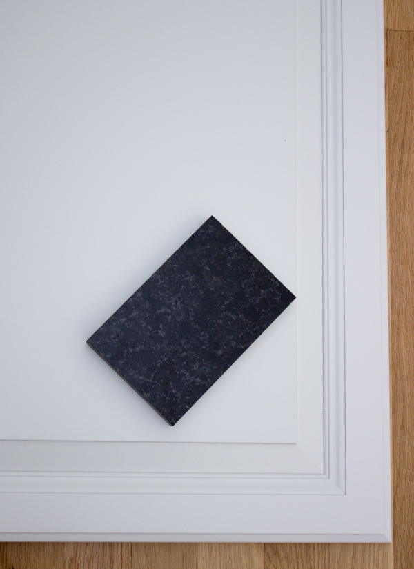 Black Pearl - Black Uba Tuba granite with white cabinets