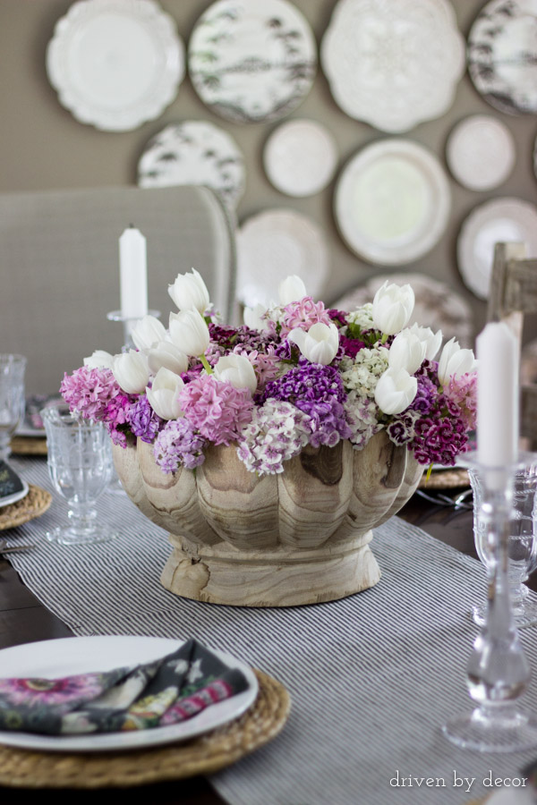 Colorful flowers in a decorative wood bowl for a simple centerpiece