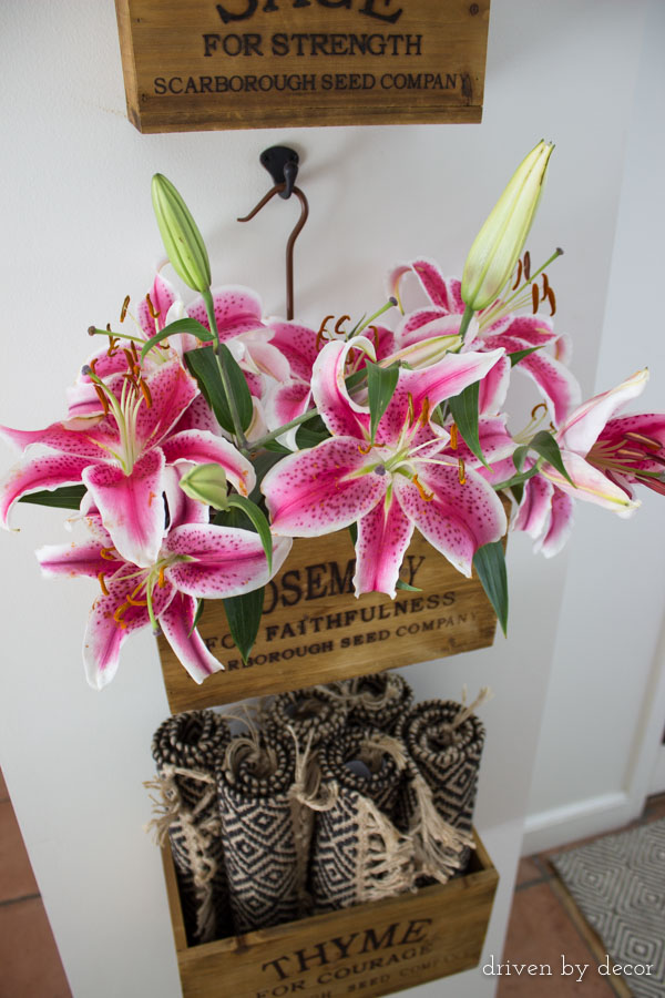 Colorful lilies in hanging wood nesting crates