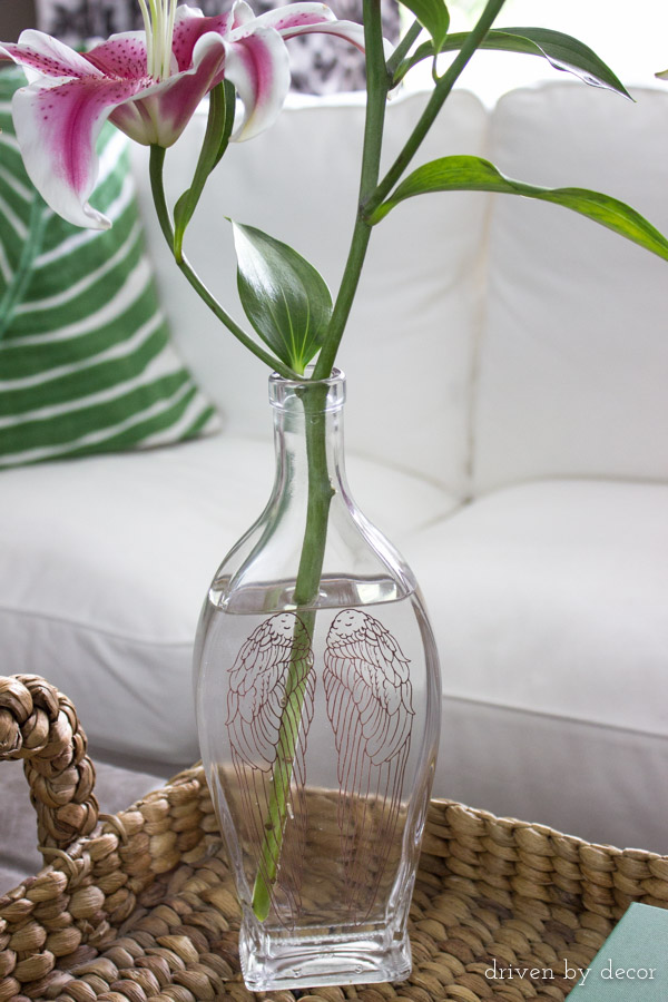 Decorative liquor bottle used as vase after using an easy trick to remove the bottle lettering