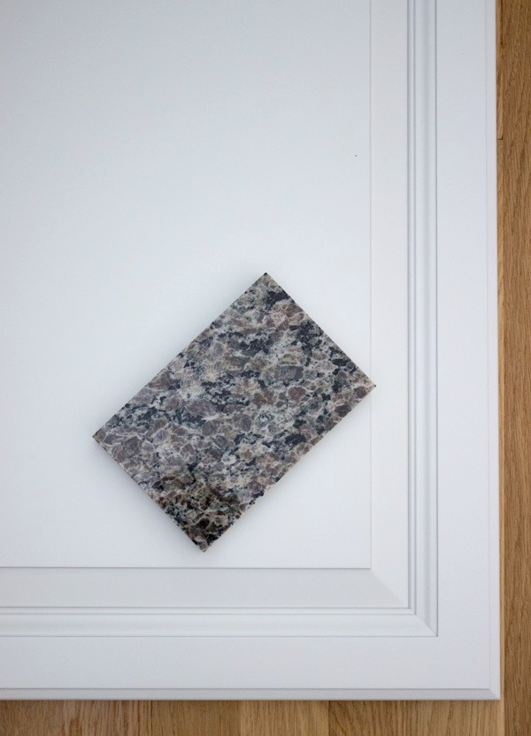 New Caledonia - Oyster Pearl granite with white cabinets