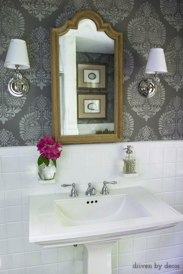 Powder room with stenciled walls and bud vase on built-in toothbrush holder!