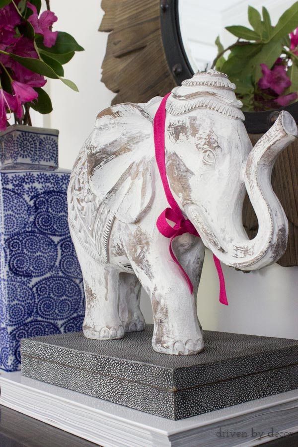 White HomeGoods elephant decorating the top of our foyer dresser
