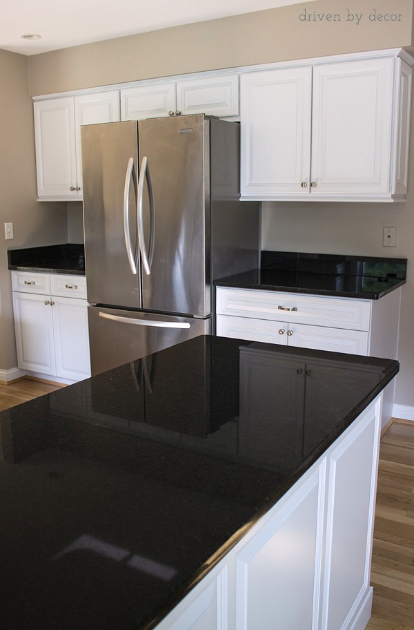 Beautiful remodeled kitchen with cabinet refacing, Black Pearl granite, and counterdepth refrigerator