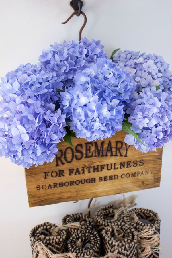 Nesting herb crate filled with hydrangeas