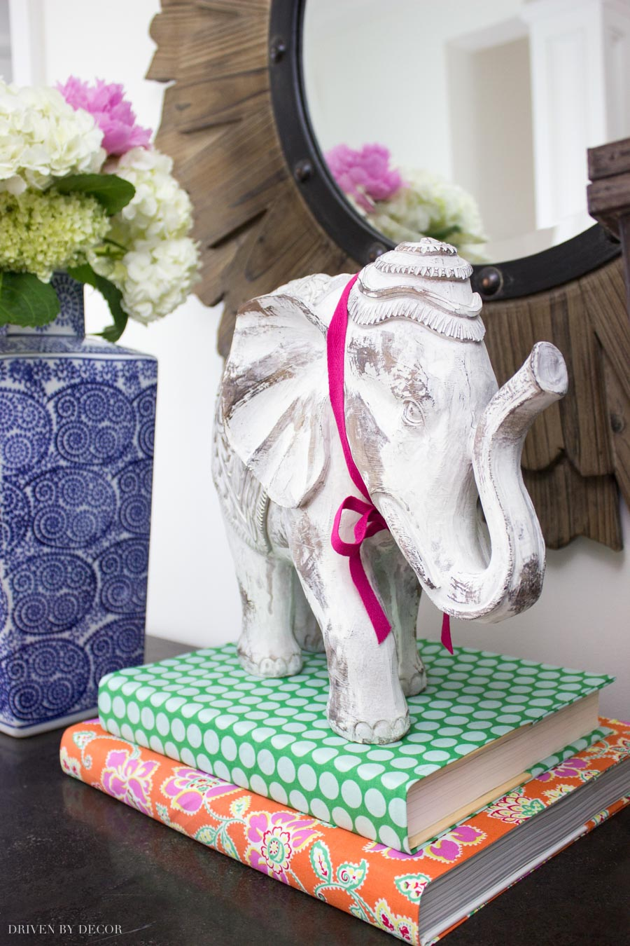 Love the idea of using fabric book covers in decorating!