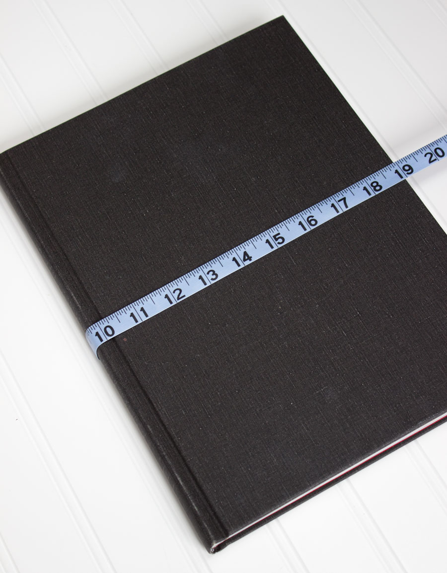 The first step to making fabric book covers is measuring