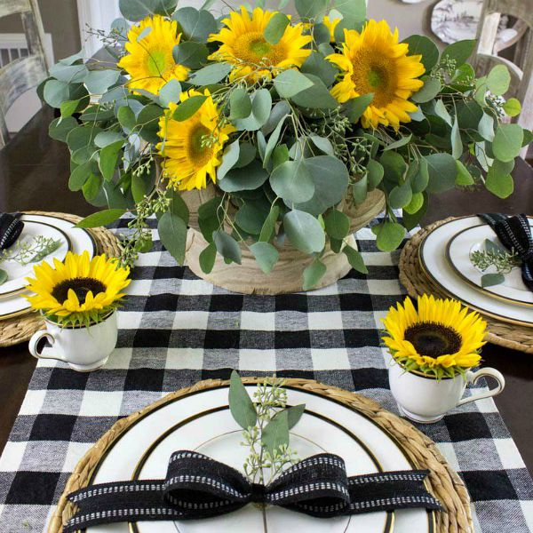 A simple fall table with black and white buffalo check and sunflowers!