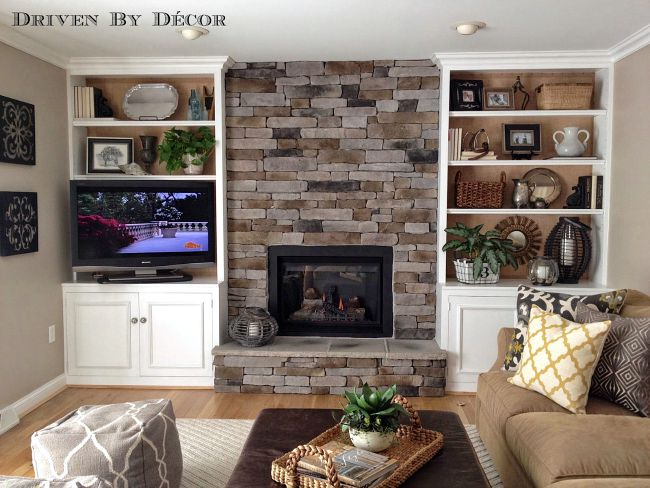 Family room with stacked stone fireplace