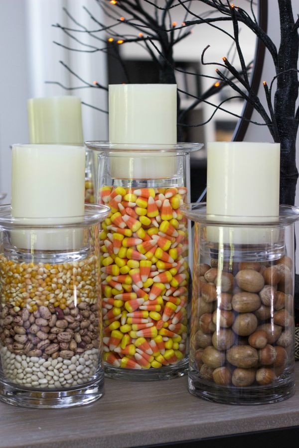 Glass pillar candle holders - change the fillers with the seasons! Love the candy corns for Halloween!