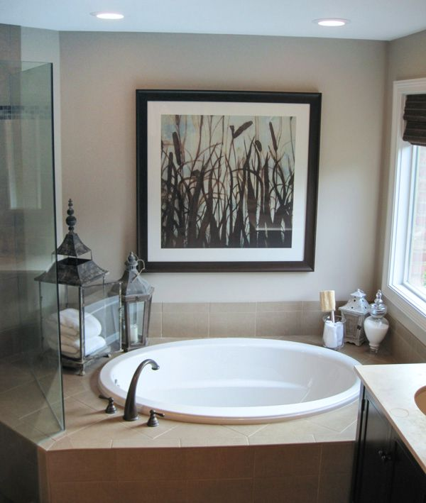 Large-scale art above bathtub