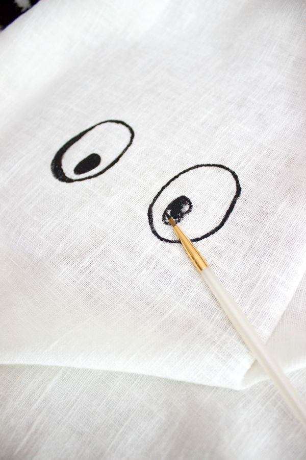 Paint eyes on pillow with craft paint