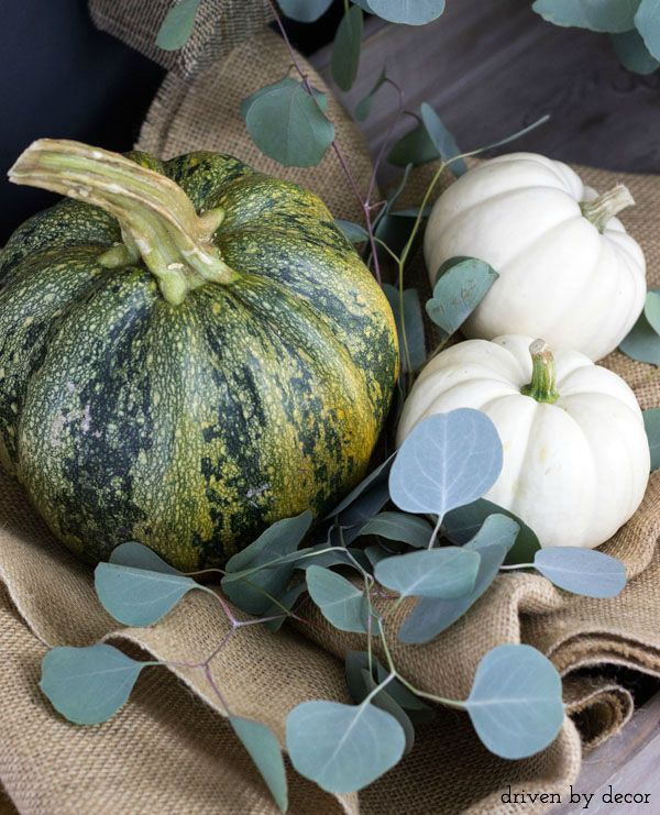 Pumpkins nestled in burlap for simple fall decor