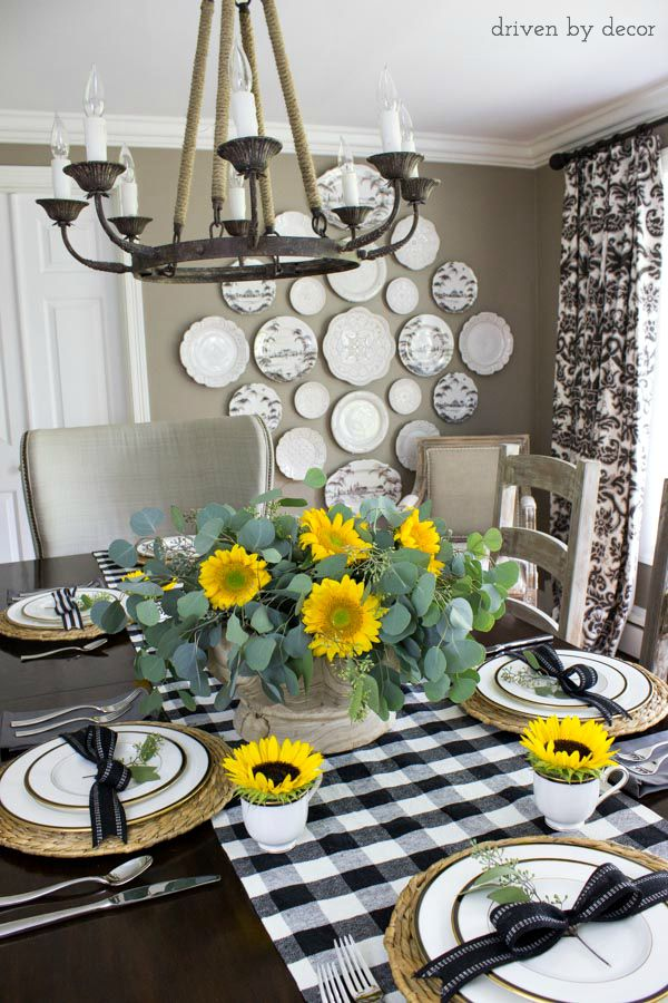 Sunflowers and black and white buffalo check runner make up this simple fall table
