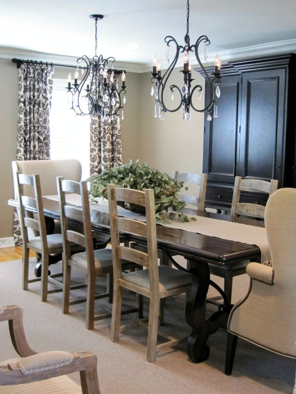 Twin chandeliers used over long dining room table