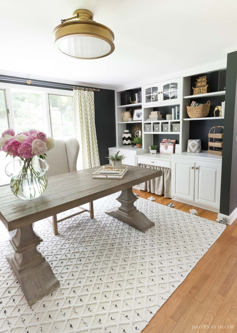 The farmhouse trestle table we use as a desk in our home office!