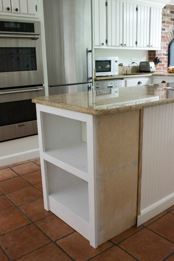 Our remodeled kitchen island with built in microwave shelf for Built in kitchen islands