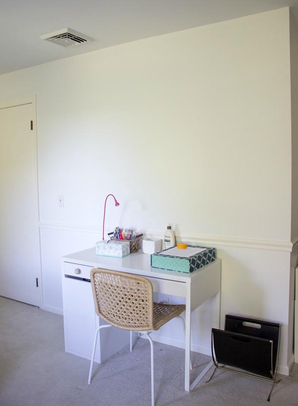 Blank wall above desk