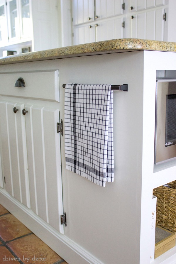 Drawer handle used to hold towel on kitchen island