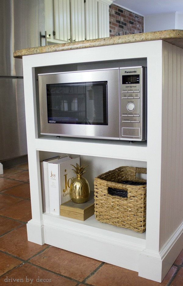 Shelves for microwave, cookbooks, and other kitchen accessories added to island