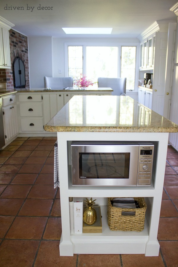 Shelving added to end of island to hold microwave - love!