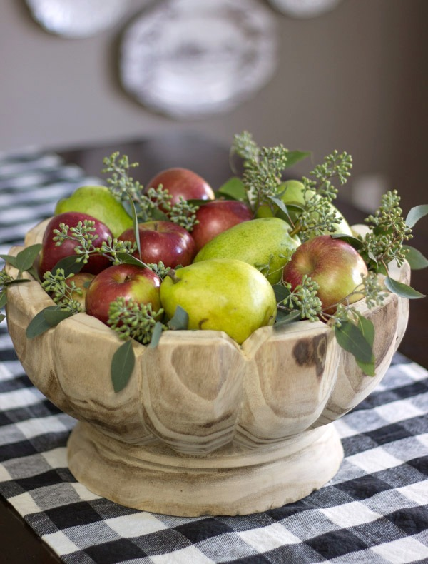 A simple fall or Thanksgiving table centerpiece created from grocery store buys - fresh apples and pears and a few sprigs of eucalyptus