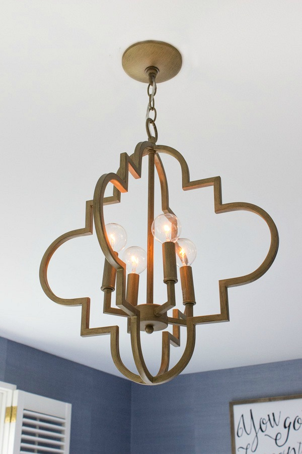 Beautiful gold arabesque chandelier - looks so cute in this bedroom!