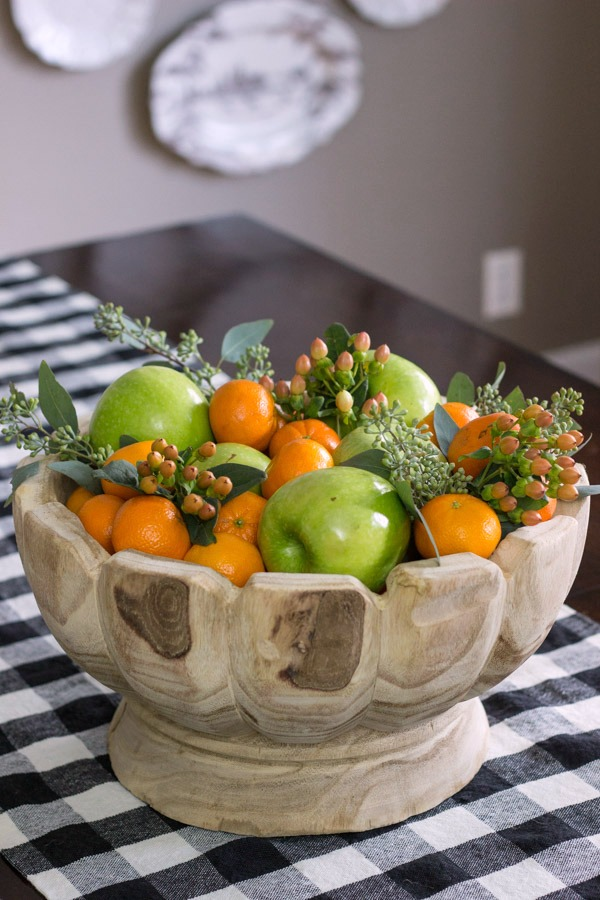 Create a beautiful holiday centerpiece with a simple run to the grocery store - clementine oranges, green apples, and a few floral sprigs