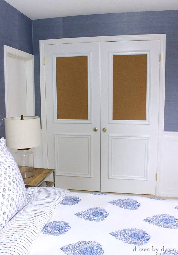 Flat closet doors framed out with panel molding including two cork boards - love for a kid's room!