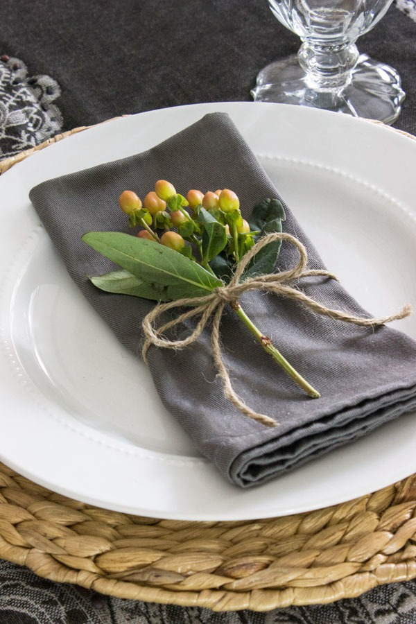 Floral sprig - tied around napkin with twine. A simple, beautiful addition to a holiday table.