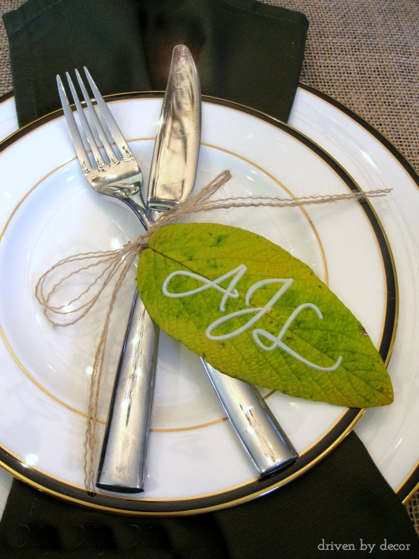 Initials placed on leaf and tied to silverware as part of a beautiful fall or Thanksgiving tablescape