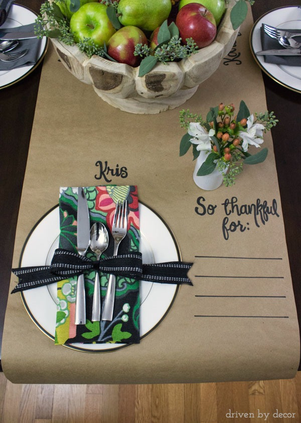 Love this simple Thanksgiving table runner cut from a roll of Kraft paper - write everyone's name at the top of the plate and a spot for listing a few things each guest is thankful for