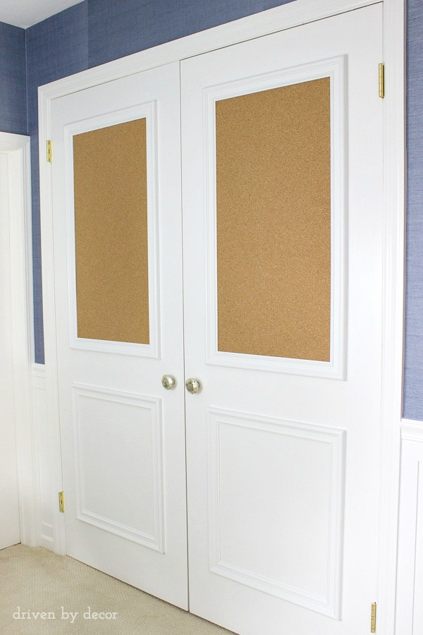 Love this upgrade of flat closet doors! Panel molding was added to both doors, including framed corkboards! So fun for a kid's room!