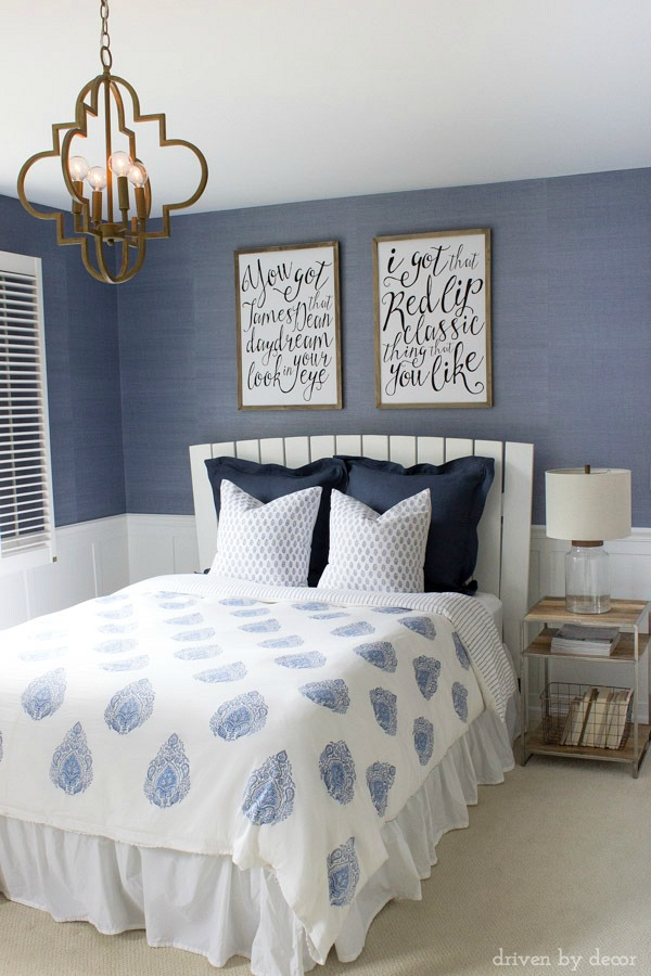 wood and chrome nightstand and blue and white bedding beautiful
