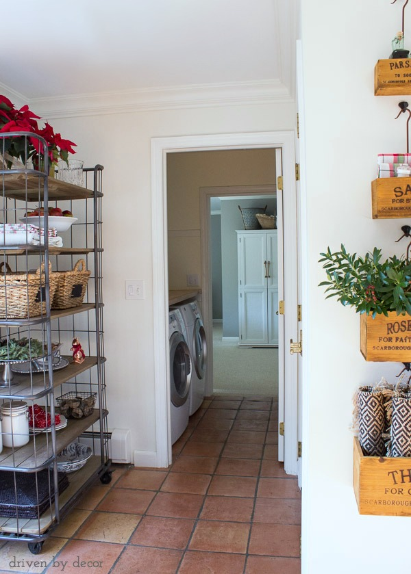 A baker's rack tucked in an unused corner and laundry room in pass through area to guest room