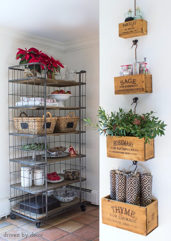 A set of hanging herb crates and a baker's rack hold our most-used kitchen necessities within easy reach