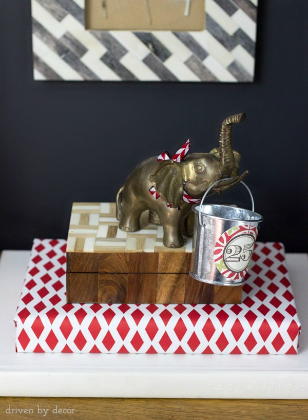 Brass elephant holding advent calendar bucket