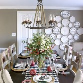 Dining room decorated for Christmas - love black and white mixed with the green and red. And that plate wall!