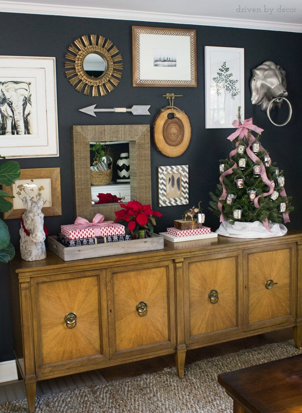 Eclectic gallery wall with long console decorated for Christmas!