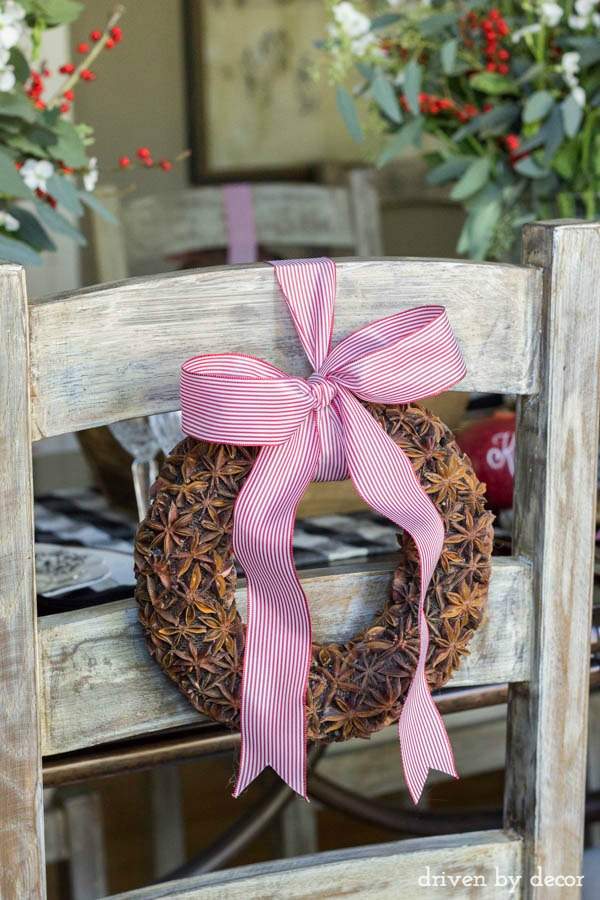 Fragrant star anise wreaths tied onto the back of dining chairs for the holidays