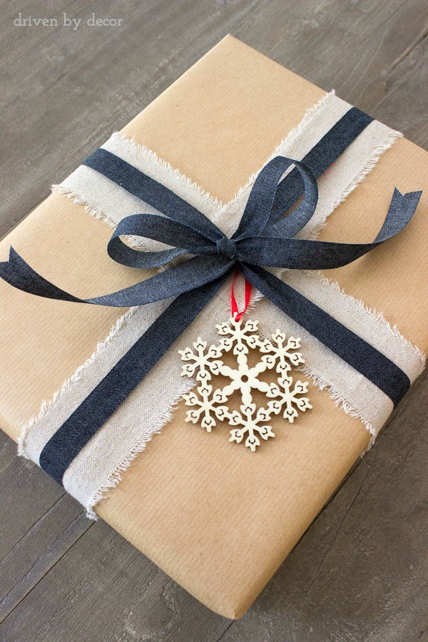 Holiday present with linen ribbon and wood snowflake ornament