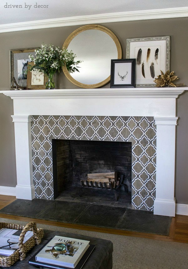 Love the fireplace tile and layered mirror and art on the mantel!