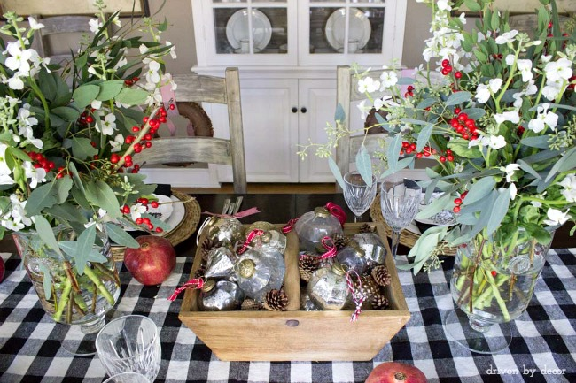 Vintage ornaments and pinecones as Christmas table centerpiece