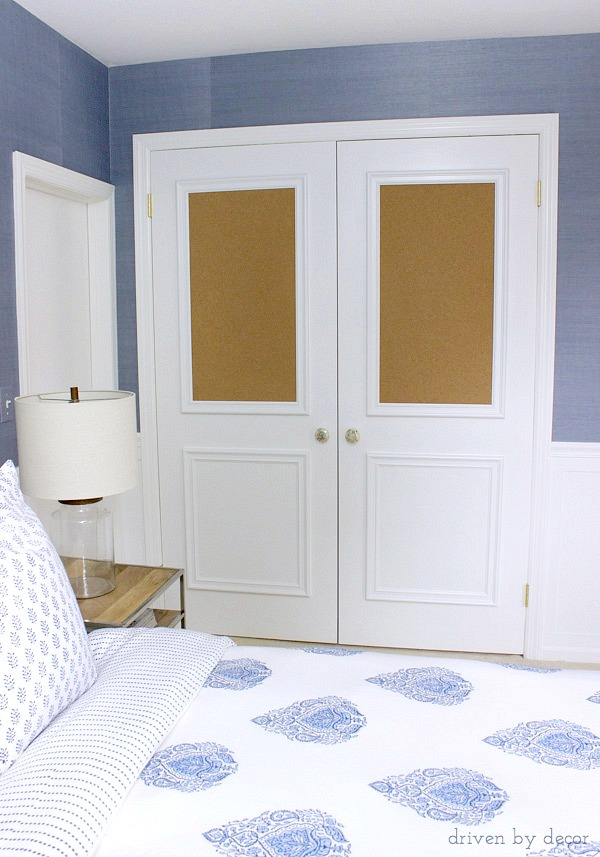 Flat closet doors framed out with panel molding including two cork boards - love this for a kid's room!