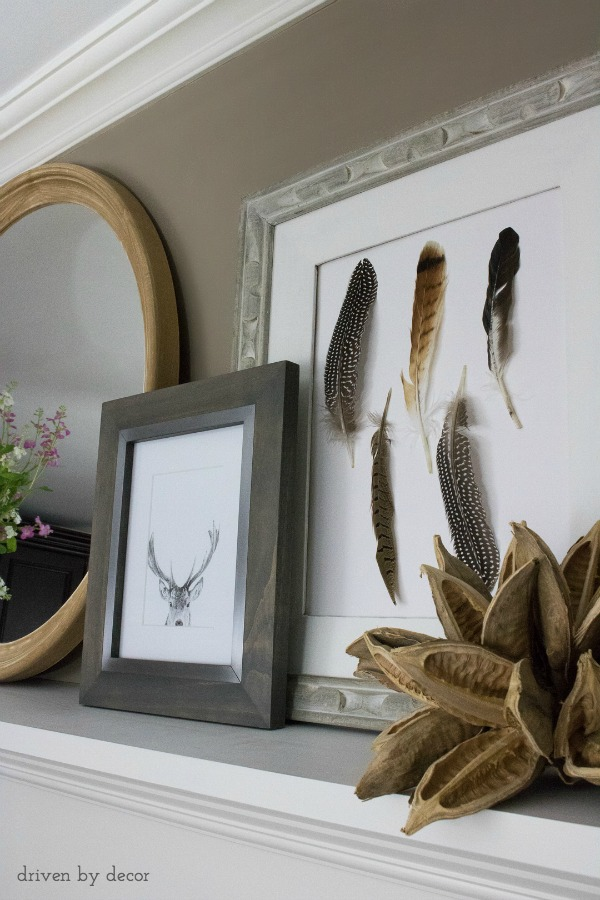 Layered art on fireplace mantel - the feather art is a quick and easy DIY!