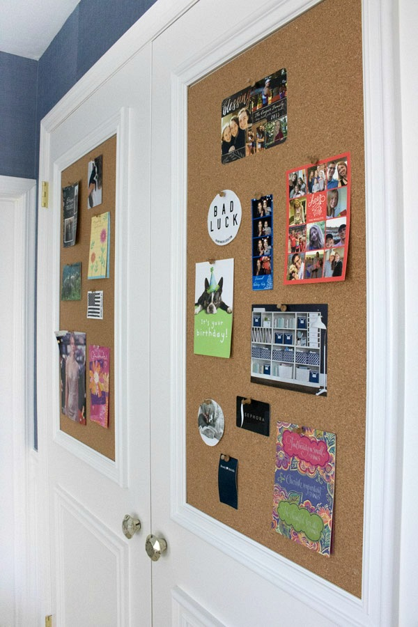 Love this for a kids room - cork boards and molding added to flat closet doors!