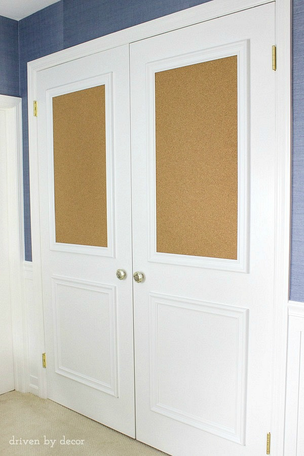 Love this upgrade of flat closet doors! Panel molding was added to both doors, including framed cork boards! So fun for a kid's room!