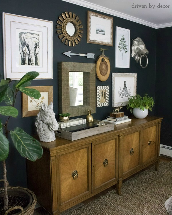 Loving the mix of framed art, mirrors, and other interesting pieces (love the lion's head door knocker!) that make up this cool home office gallery wall
