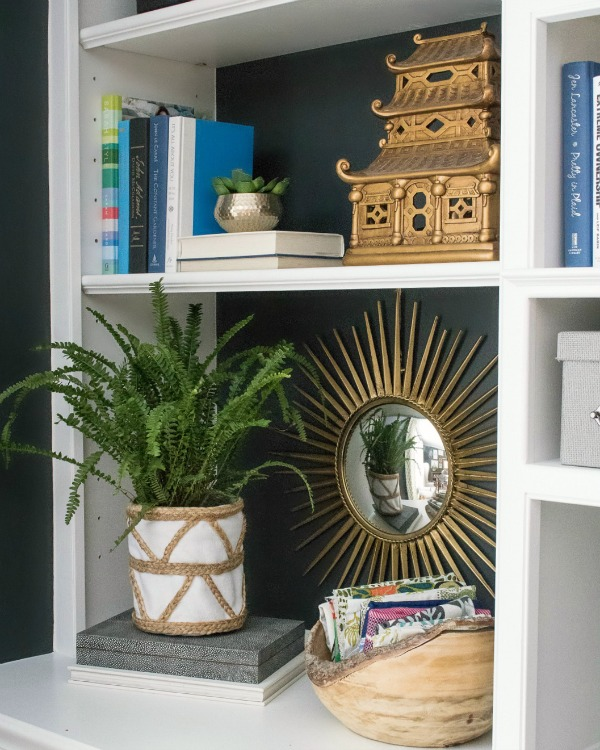 Shelf styling - love the idea of putting a plant inside of a small basket