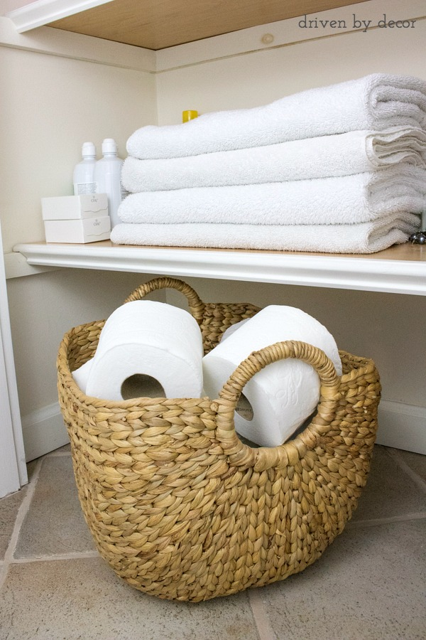Unwrap new TP and store the rolls in an open basket in the bathroom - those lazy family members will be much more likely to change the TP roll!